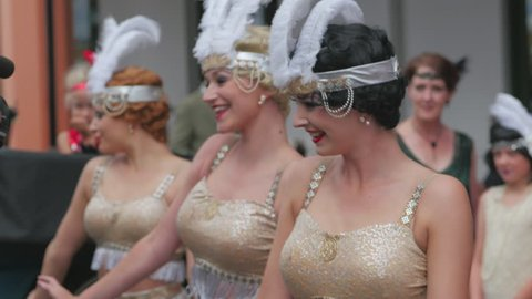 Napier, Hawkes Bay / New Zealand - 02 19 2016: Napier, New Zealand, February 20th 2016. 1930's style chorus girls dancing in the street during Art Deco Festival.