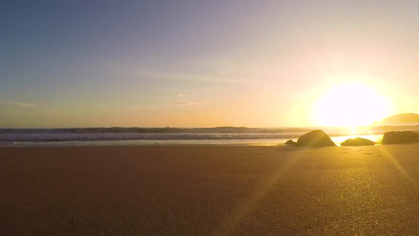 Time-lapse footage of a sunset at the ocean beach in Portugal.   Shutterstock HD Video #1017697741