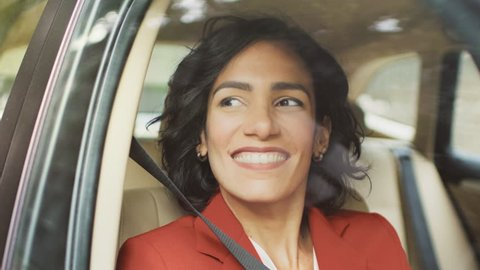 Beautiful Young Woman Rides on a Passenger Seat of a Car, Looks in Wonder out of the Window. Camera Mounted outside Moving Car.