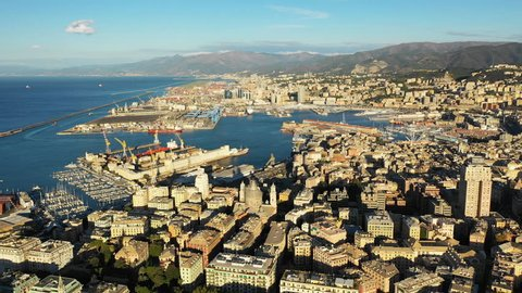 Aerial panoramic view of cityscape of Genoa (Genova), famous port and capital city of Liguria at sunrise - landscape panorama of Italy from above, Europe