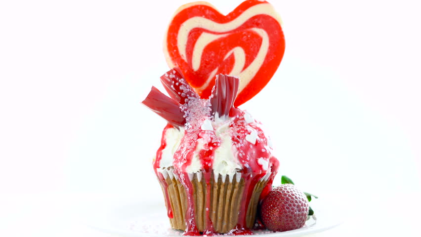 Red and white theme colorful novelty cupcake decorated with candy and large heart shaped lollipop for Valentine's, Mother's Day and birthday celebration. | Shutterstock HD Video #1017925321