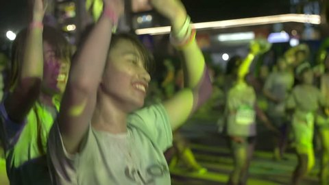 Ha Noi, Vietnam - June 9th 2015. Thousands of colorful runners were throwing powder, dancing and celebrating the Color Me Run festival in Vietnam.