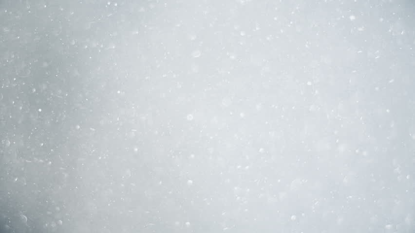 beautiful snow is falling in slow motion / macro close-up, snowing, winter