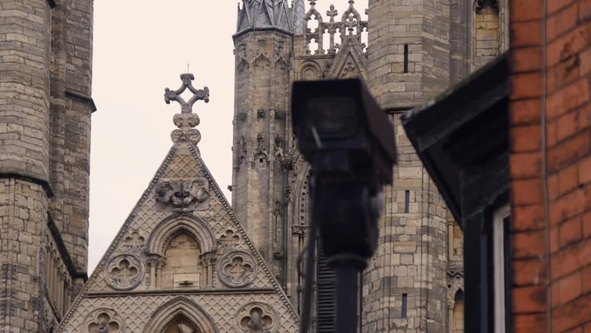 Pull focus from a cathedral in the background to a CCTV camera in the foreground. | Shutterstock HD Video #1017990571
