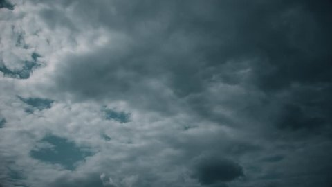 Dramatic and dark clouds form out of nowhere and obscure the sky - in time lapse.
