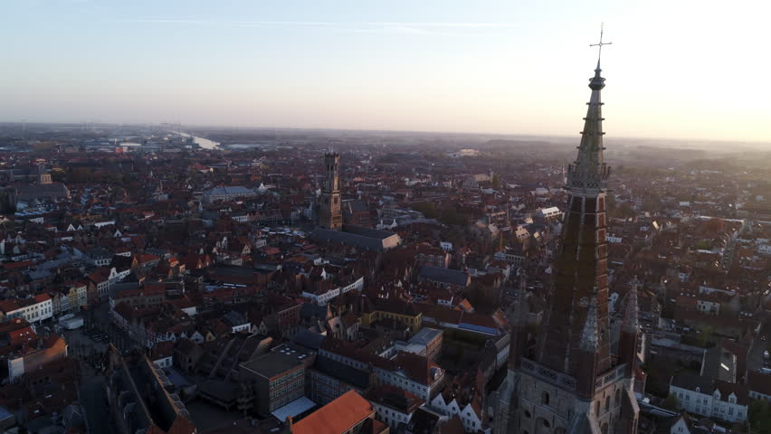European city view from the top. Circle around steeple Church of Our Lady. Bruges, Belgium | Shutterstock HD Video #1018104001