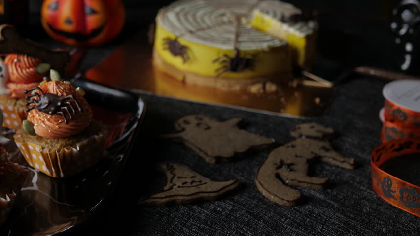 Fancy Halloween food Party Table with Pumpkin Cupcake Muffin and cookies.   Shutterstock HD Video #1018135921