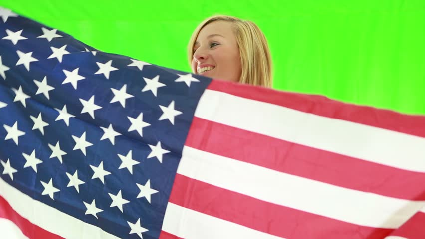 Young woman with USA flag. Green screen    Shutterstock HD Video #1018174771