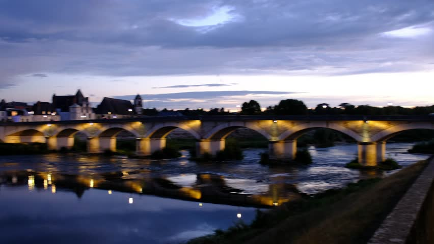 Amboise-France/Loire - October 10 2018 - The Royale d'Amboise castle reflecting in the Loire river at dusk  Motion view