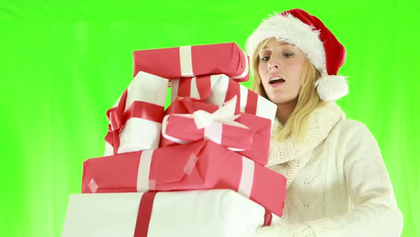 Busy Christmas shopping-Woman falling with presents. Green screen | Shutterstock HD Video #1018174951