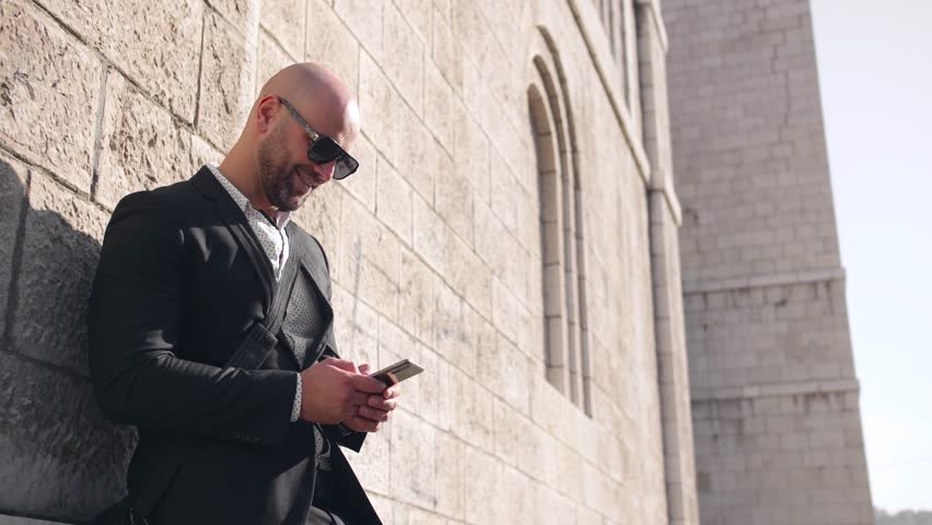 Handsome businessman typing on the phone  | Shutterstock HD Video #1018184191