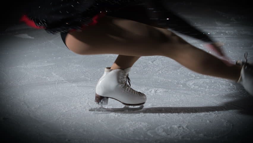 This talented young figure skater is keeping her balance when she spins on the ice. | Shutterstock HD Video #1018282471