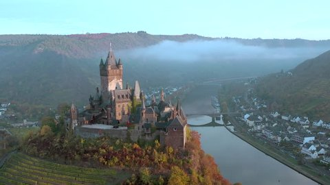 Sunrise Aerial View of the Town of Cochem and the Castle Overlooking the Beautiful Riverside City in the Autumn