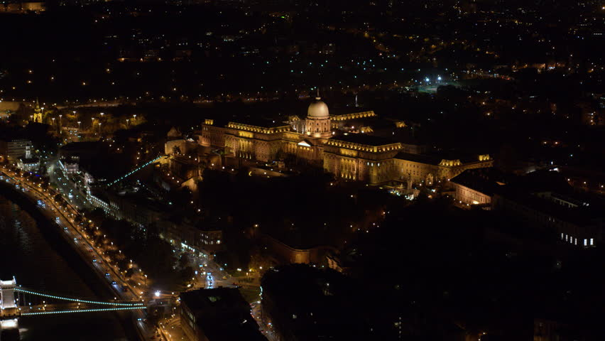 Aerial view of the Buda Castle and Chainbridge in downtown Budapest at night - drone 4K video | Shutterstock HD Video #1018452271