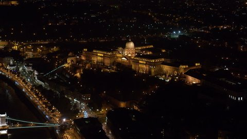 Aerial view of the Buda Castle and Chainbridge in downtown Budapest at night - drone 4K video