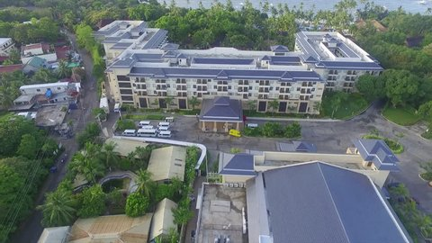 aerial shot of a building in a beach resort