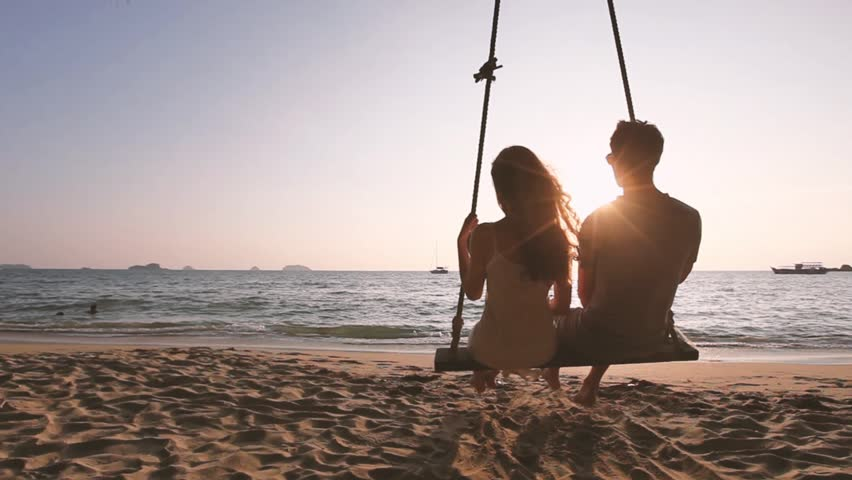Happy honeymoon getaway holidays, romantic couple on the beach, vacation travel. | Shutterstock HD Video #1018521451