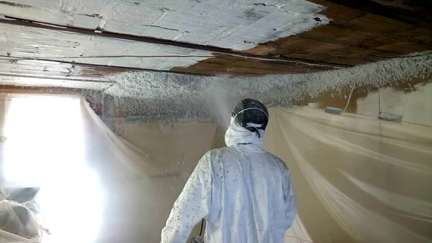 Workman spraying foam insulation material into ceiling in old cave. | Shutterstock HD Video #1018559971