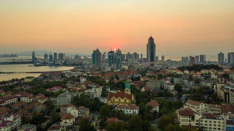 Aerial hyper lapse of Qingdao cityscape at sunset
