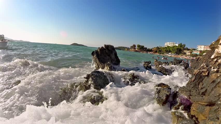 Gentle sea waves touching rocks of Grand Cayman