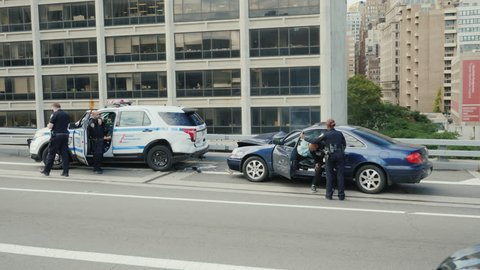 New York, USA, October 2018: Traffic accident involving a police car. Another car crashed into the parked cars, and the airbag was annoyed. The police car has a broken rear bumper