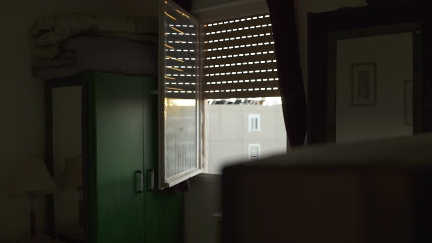 Open window in an old apartment in low income apartment building