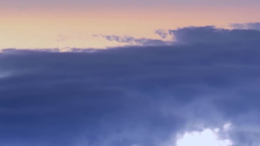 Sunset clouds time lapse, fast moving sunny orange clouds rolling, nice orange horizon. Beautiful aerial view. | Shutterstock HD Video #1018639111