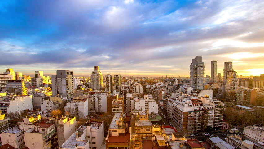 Time-lapse view on the skyline of the city as colorful clouds pass by in the light of the setting sun in Buenos Aires, Argentina.  | Shutterstock HD Video #1018703281