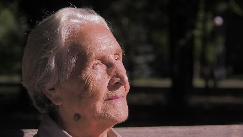Portrait of an old woman. | Shutterstock HD Video #1018731121
