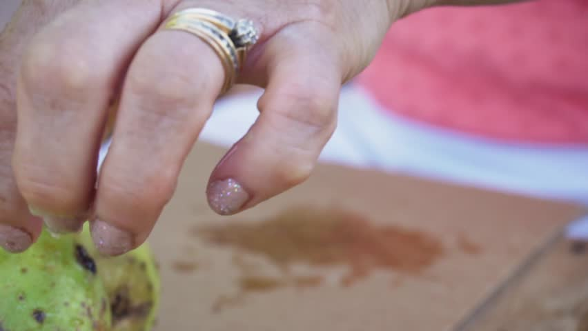Close up on woman's hand cutting a prickly pear. | Shutterstock HD Video #1018770121