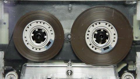 vintage transparent audio cassette tape in the deck