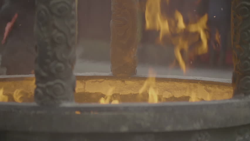closeup of flame in a fire pit (slow motion).