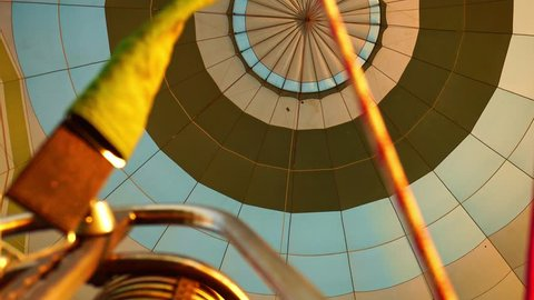 Hot Air Balloon Inflating. Hot Air Balloon fire flame. Hot air from a gas burner fills the dome of the balloon.