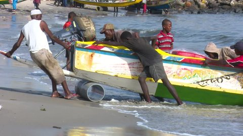 Dakar, Senegal - 07 25 2016: Dakar, Senegal - July 26, 2016: The typical Soumbedioune fish market in Dakar with fish-boat and sellers