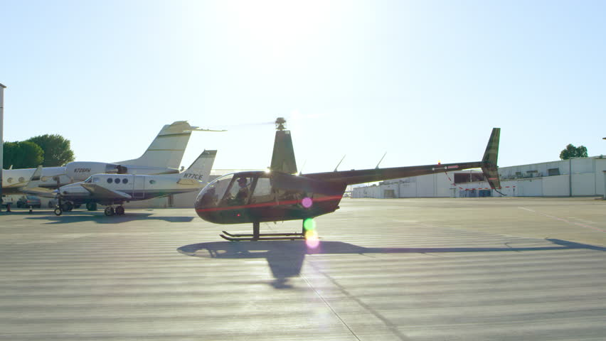 View of helicopter hovering at airport during daytime in Los Angeles, California. Shot on 4K RED camera.