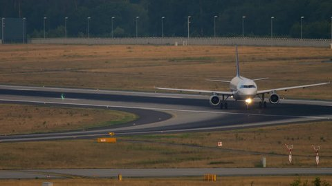 FRANKFURT AM MAIN, GERMANY - JULY 19, 2017: Lufthansa Airbus 320 taxiing after landing at 07L. Fraport, Frankfurt, Germany