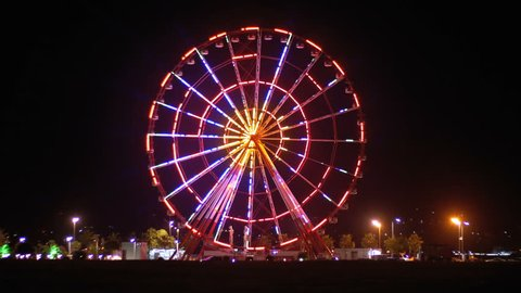 BATUMI, GEORGIA, OCTOBER 26, 2018: Ferris Wheel Lights at Night. Neon colored lights flashing on the Ferris wheel. Embankment of Batumi, Georgia.