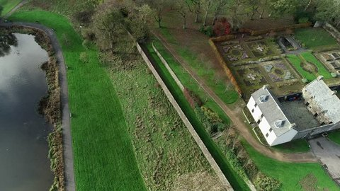 Easterhouse, Glasgow, Scotland, UK; November 4th 2018: Aerial footage of  Provan Hall, a medieval fortified country house, surrounded by trees in Auchinlea Park.