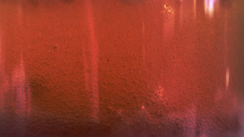 Red liquid with air bubbles #1019210551