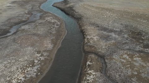 Aerial once a deep lake severe drought now stream. Severe intense drought Utah, lake and rivers to dry out. Global warming, climate change. Livestock and wildlife in danger of starvation.