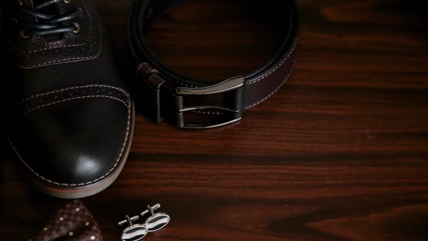 Men's accessories, butterfly shoes cufflinks and belt. | Shutterstock HD Video #1019302201