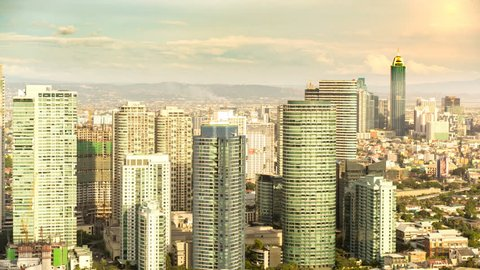 METRO MANILA, PHILIPPINES - CIRCA MARCH 2018: Time-lapse view on the skyline of Makati as clouds pass through the blue sky circa March 2018 in Metro Manila, Philippines.