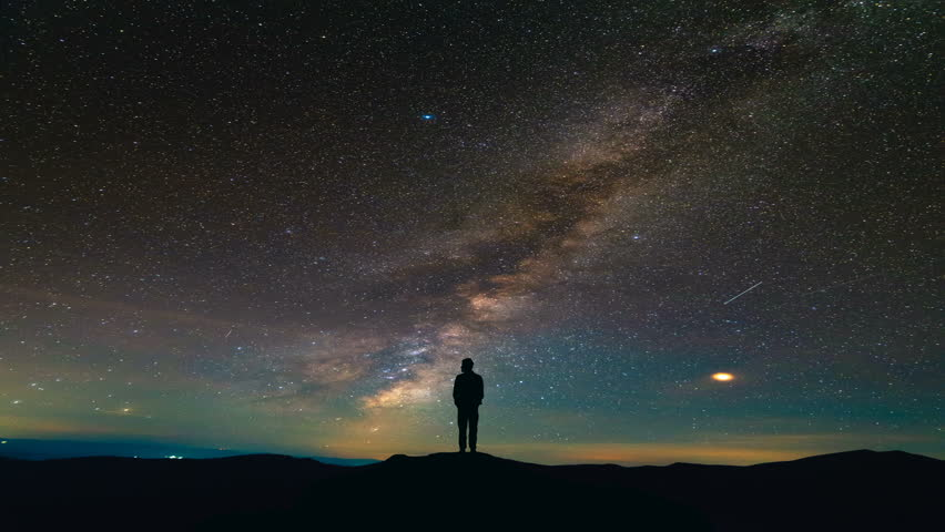 The man standing on the meteor shower background. time lapse #1019362321