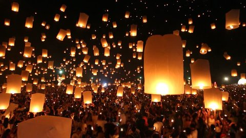 Many Sky Fire Lanterns Floating Up To The Sky In Yee Peng Lanna International Festival Travel Destinations Of Chiang Mai, Thailand (tilt up)