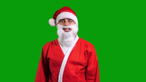 Santa Claus in red costume on green chroma key background. Christmas and New Year celebration concept