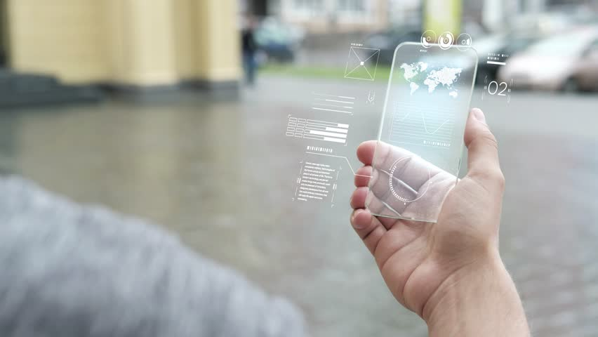 Future is now. Man using smartphone with futuristic touch screen. Closeup of a male's hand holding a mobile telephone. Concept of the near future and technologies. White screen backlight | Shutterstock HD Video #1019581561