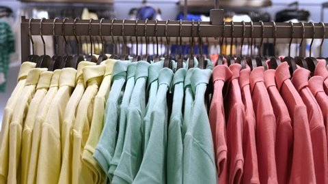 Colorful Polo T-Shirts Displayed On Hangers At Clothing Store. Close-Up.