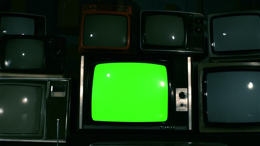 "80s TV Green Screen with Many 80s Tvs. Dolly Out. Blue Steel Tone. Ready to Replace Green Screen With any Footage or Picture you Want. You Can Do it With ""Keying"" (Chroma Key) Effect in After Effect. 
