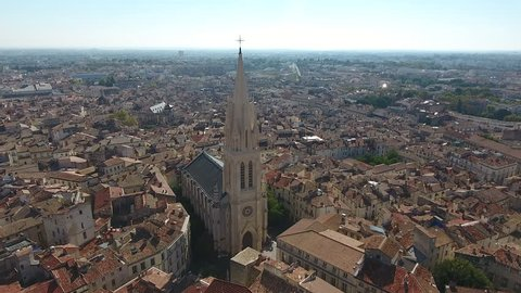 Zoom out over Montpellier Sainte Anne church sunny day aerial view