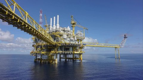 4K time lapse, Offshore oil and gas business, Central processing platform produced raw gases and condensate or crude oil then sent gas to onshore refinery.